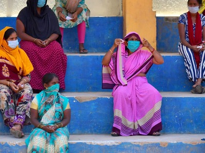 India's virus cases decline but WHO expert says positive tests ominously high