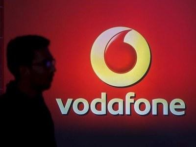 Vodafone edges back into annual profit