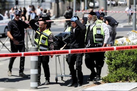 Two Israeli stabbed in East Jerusalem, assailant shot dead