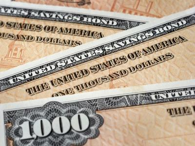 U.S. yields lower amid strong demand for two-year note auction