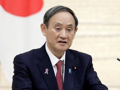 Japan's PM fine-tunes spending plans