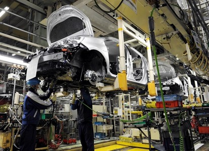 Carmakers in 'India's Detroit' allowed to operate
