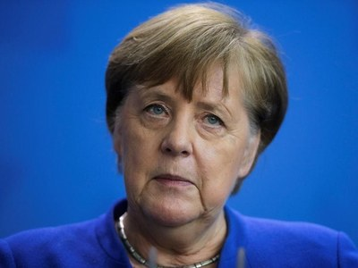 Momentum with Merkel party after victory in key state poll