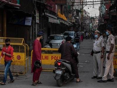Delhi, Mumbai loosen lockdowns as India virus crisis eases in cities