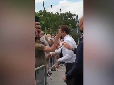 French president slapped by by-stander during walkabout