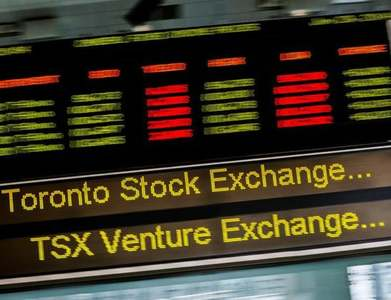 TSX stays in the red as BoC holds rates, financials fall
