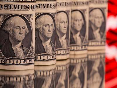 Dollar surges to 2-month high on Fed rate-hike projection