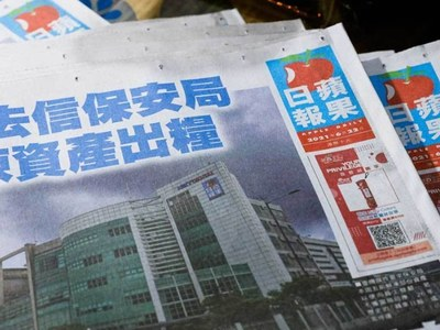 Hong Kong police arrest Apple Daily columnist under security law