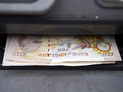 Sterling edges lower against dollar