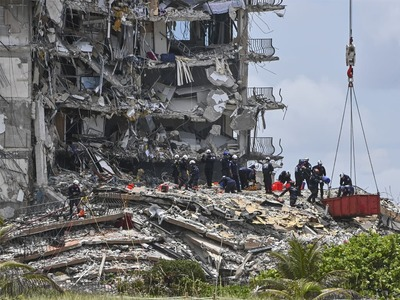 Search teams persevere as death toll in Florida condo collapse rises to 9
