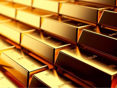 Gold eases on firm dollar, Fed officials' hawkish views