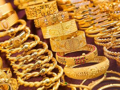Gold dips on firmer dollar as market eye US jobs data