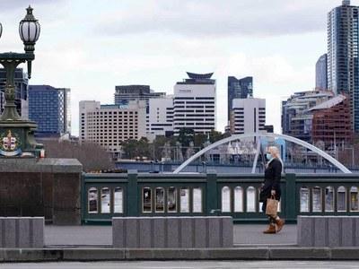 Australia, under lockdown, reports slight dip in COVID-19 cases