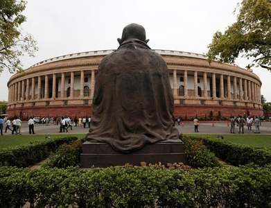 India minister says regulators probing Adani firms, shares fall