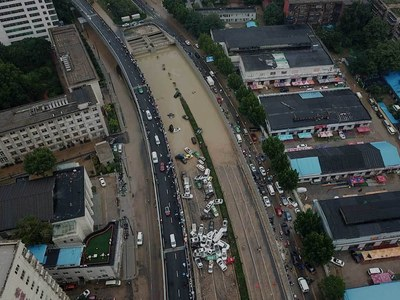 Chinese city picks through the debris after record rains kill 33