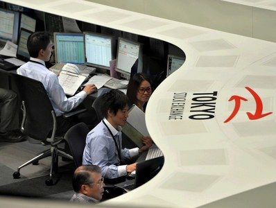 Japanese shares track global peers higher, but virus woes cap gains