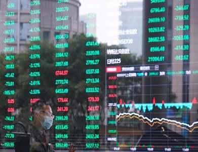 Shanghai shares edge lower, yuan firm as state media urges calm