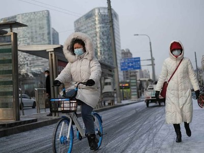 Chinese cities test millions as virus cases surge
