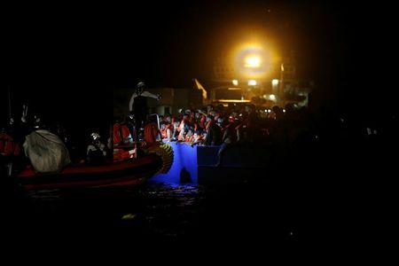 Rescuers pull 394 migrants from overcrowded boat off Tunisia
