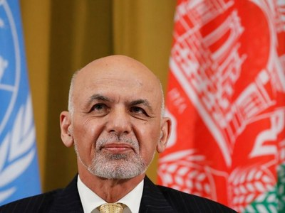 Afghan president Ghani flies into besieged northern city as Taliban extend gains