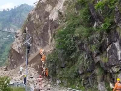 Ten dead, 60 people feared trapped in India landslide