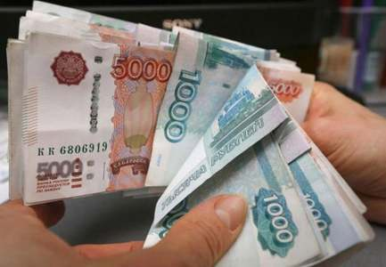 Russian rouble eases after overnight jump, stocks inch higher