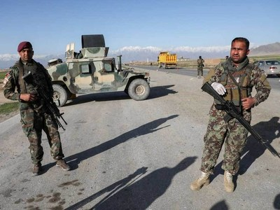 Afghan forces abandon third largest city to the Taliban as blitz continues