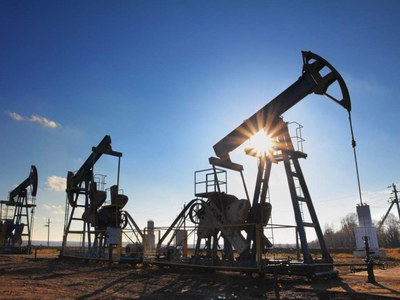 Oil slips but set for weekly gain