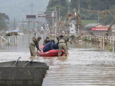 Heavy rain triggers floods, landslides in Japan