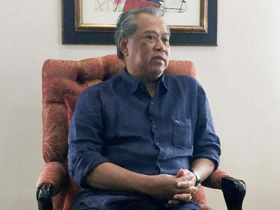Malaysia's king keeps Muhyiddin as interim PM after resignation