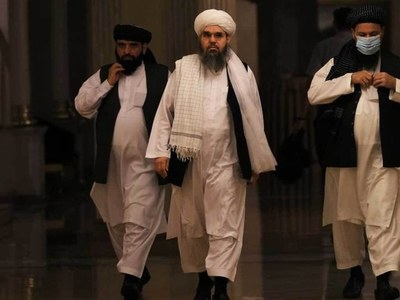 Taliban pledge to be 'different', as Afghans flee