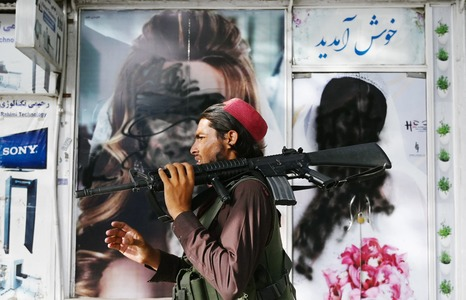 Images of women vandalised as Kabul faces up to Taliban rule