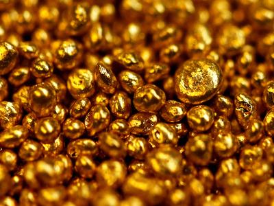 Gold falls as Fed's taper talks boost U.S. dollar