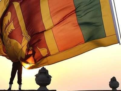 Sri Lanka raises rates as rupee falls to record low