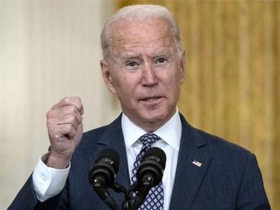 Biden's nearly $5trn spending plans win key House vote