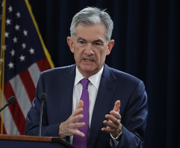 Fed chief signals US economy may be ready for less stimulus by year end