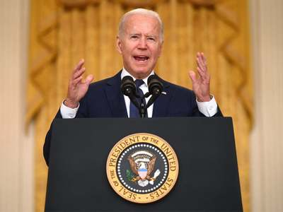 Biden cites Afghan military, Trump role in messy exit