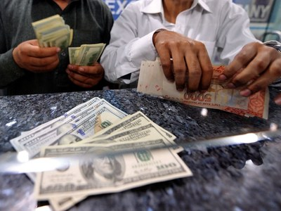 Rupee's fall continues, closes over 167 in inter-bank market