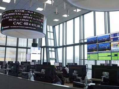 European stocks end near record highs as tech rallies