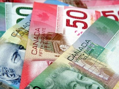 Canadian dollar slides to 1-week low ahead of BoC rate decision