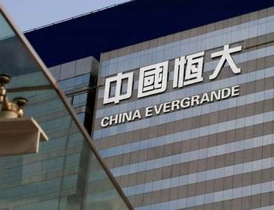 China Evergrande bonds fall sharply on default worries, onshore bond temporarily suspended