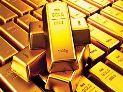 Gold gains as dollar slips, brighter U.S. jobs data checks gains