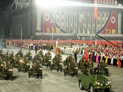 Machines not missiles on show at North Korea anniversary parade