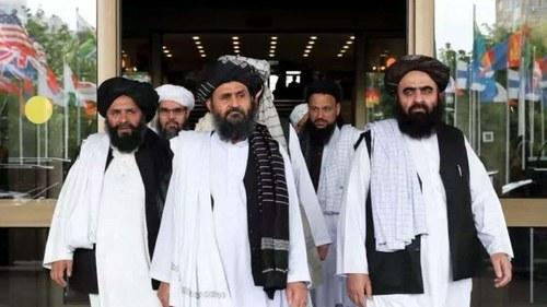 Taliban say will allow women at universities