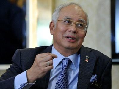 Malaysia's Najib may seek re-election to parliament despite conviction