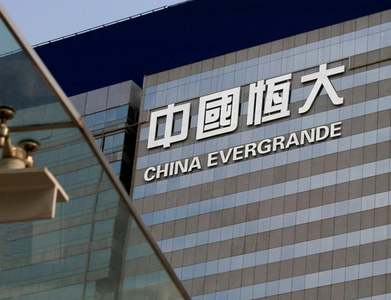 Struggles facing China's Evergrande not panicking markets