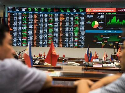 Philippine stocks cheer record low rates, virus spike hits Singapore