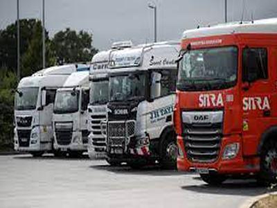 Long queues, fuel rationing as UK faces truck driver shortage