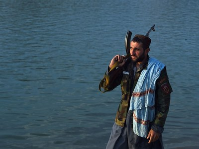 Taliban fighters hit the fairground as Afghans fear for freedoms