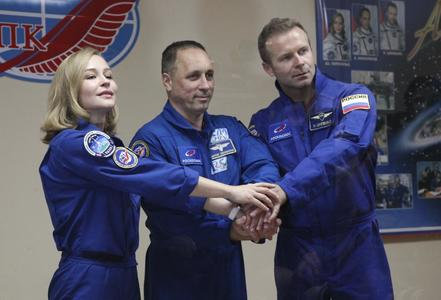 Russian crew arrives at space station to film first movie in orbit